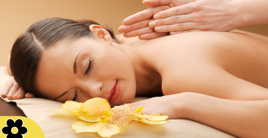 Woman Relaxing While Getting Back Massage By A Massage Therapist in a Renowned Massage Center.