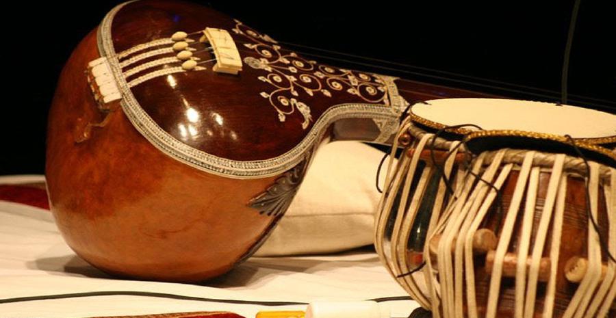 Tradional Musical Instruments Veena and Tabla on display.
