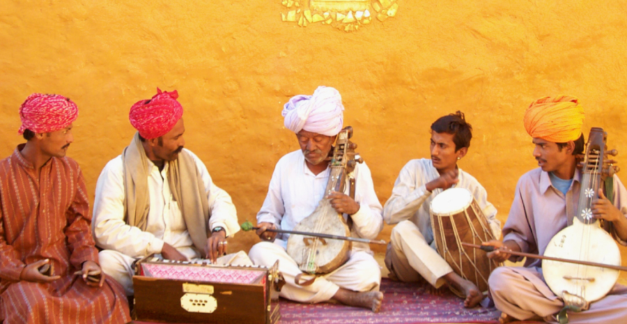 Traditional Folk Musicians of Rajasthan performing in an outdoor event.