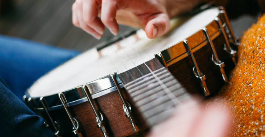 Close-up View of playing guitar by a girl.