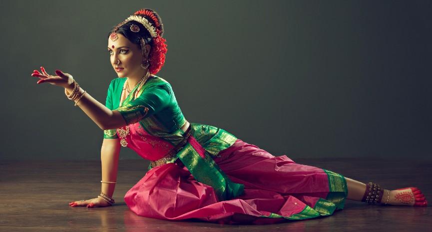 Beautiful Indian girl dancer in the Indian dance posture . Indian classical dance Bharatanatyam